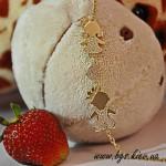 Подарок на рождение ребенка молодой маме - золотой мамин браслет с фигурками