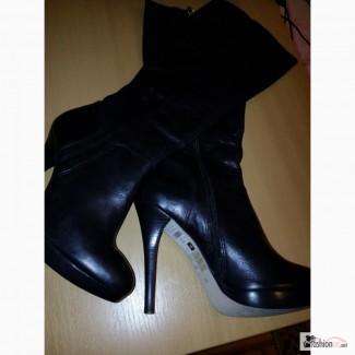 Продаю новые кожаные стильные сапоги