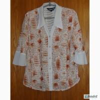 Трикотажная блузка с бежевым цветочным принтом. Размер 52 производство Китай